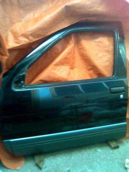 Puerta lado chofer, compatible con modelos nissan (patfhinder, terrano.)