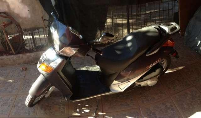 Vendo mi moto esta en excelente estado año 2011