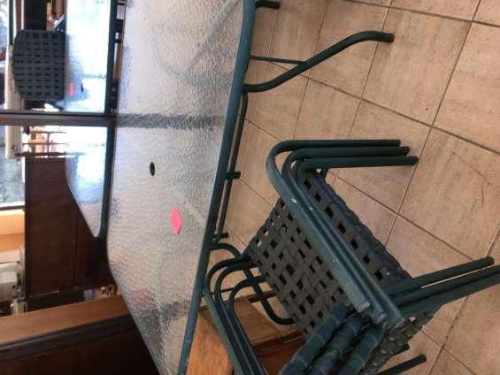 Mesa de terraza con 6 sillas $100.000.-