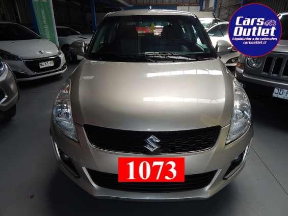 Suzuki swift gl hb 1.2 2015 $5.690.000 plateado plata gasolina km 87.904 a/c abx2 alzavidrios electrónicos espejos electrónicos isofix llantas de aleación www.carsoutlet.cl